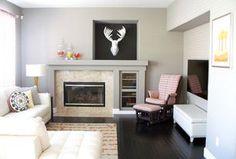Contemporary Living Room with Hardwood floors, Built-in bookshelf, Leather sectional sofa, Home decorators sonnet area rug  | bocadolobo.com | #rug #rugs #luxuryfurniture #luxuryrugs