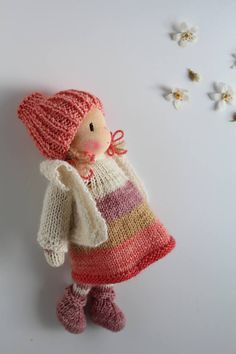 Shy little Poppy. Poppy is a small knitted Waldorf inspired doll made in The Netherlands from all natural materials: Swiss cotton knit doll fabric, clean carded wool, eco and fairtrade hand dyed merino yarn and a crocheted curly mohair wig. Her face is hand embroidered and her cheeks are blushed with Stockmar beeswax crayon. She is about 8 inch (20 cm tall). This sweet little doll will become your very best friend. Poppy is handknitted by me from luxuriously soft eco and fairtrade Merino…