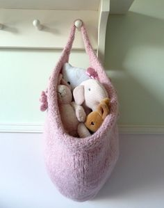 This one's all on mama, but we love the idea of knitting one of these felted storage bags as an alternative...
