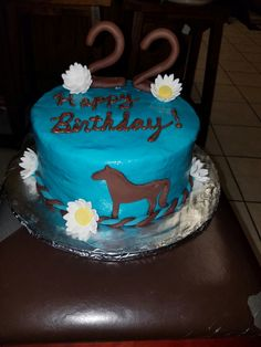 Teal horse themed birthday cake