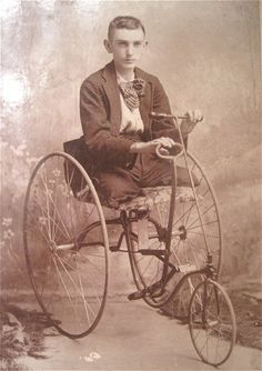 Legless young man on a custom hand-pedaled velocipede, c.1885.