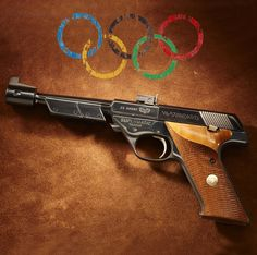 "William McMillan's Hi Standard. ""This pistol was used by Lt. Col. William McMillan, United States Marine Corps, in winning the Gold Medal in Rapid Fire Pistol during The Olympic Games of 1960 in Rome, Italy. His 587 of a possible 600 score secured the only Gold Medal won by the U.S. in the shooting sports during that Olympiad."""