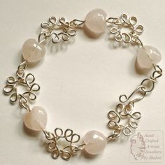 Rose Quartz Heart Shaped beads and Silver Plated Copper Wire Bracelet with a hook clasp. The bracelet is 8.5″ long. £17.00