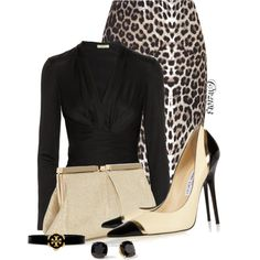 Very elegant.  The bold skirt is tempered by the simple classic blouse, shoes and jewelry.