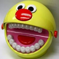 """Brushy Ball..coming soon.  Pearly white teeth light up in sequence as Brushy talks your child through a """" follow-the-leader"""" tooth brushing session."""