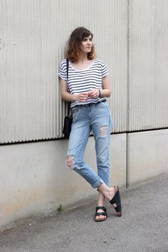 High-waist ripped jeans, striped shirt and Birkenstocks.