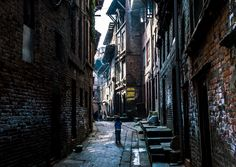 Nepal, Alley - The small boy walked into the old alley, maybe we was going home.