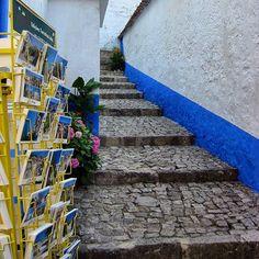 By the streets of Obidos . Pelas ruas de Óbidos #obidos #walkinginobidos #streets #portugal #oeste #westregionofportugal #hotelrealdobidos #obidoscastle #landscape #tourism #hotel #fourstars #hollidays #stairs #relax #placetovisit #destination #happytime #sogood #perfectfortwo #bomdia #greatday #vacations #ferias #romanticdestination #charme #oestealive #portugal_de_sonho #portugalalive #placetovisit #details