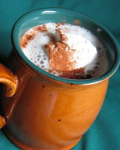 I make this in a French Press, but could be made with drip coffee. For hot milk, I use a glass milk-frother. Heat milk in microwave and use plunger to froth lightly. Strain milk into coffee, remove lid, and put some foam on top of coffee.