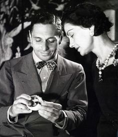 Jewelry designer Fulco di Verdura and Coco Chanel. He designed her iconic Maltese Cross cuff bracelets she wore on both wrists. He was the head jewelry designer at Chanel from 1927-1934.