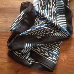J. Crew scarf, lightweight Awesome summer weight scarf from J. Crew.  On trend graphic  geometric pattern in black, blue, and white.  From spring 2015.  Excellent used condition from my pet free, smoke free home. J. Crew Accessories Scarves & Wraps