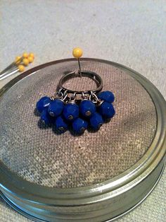 IAmRoyalty finger peace is crafted with antique silver elements, and driven to brilliance with 10 sapphire blue 6mm Czech multi-faceted glass beads. Who says royalty can't be simple? $22