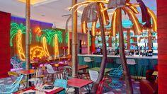 Bananas has a kitsched-up tropical colonial vibe going, with palm tree lights El Born Barcelona, Cafe Concept, Estilo Tropical, Caribbean Culture, Café Bar, Murals Street Art, Neon Lighting, Restaurant Design, Event Decor