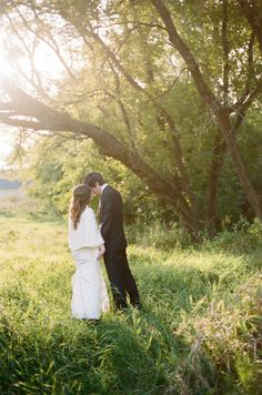 couple being adorable in a field