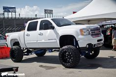 Love white trucks, love them even more when they're lifted and a GMC. :)