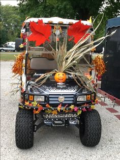 The front of a golf cart decorated for a parade...