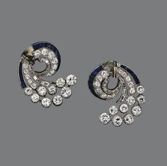 PAIR OF DIAMOND AND SAPPHIRE EARCLIPS, CIRCA 1930 The scroll motifs set with 64 old European-cut, round, square-cut and baguette diamonds weighing a total of approximately 4.50 carats, the borders decorated with calibré-cut sapphires, mounted in platinum.