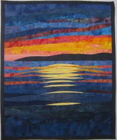 What a pretty sunset art quilt!