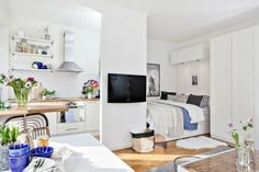 white walls and beige laminate floor, inside a one-bedroom home, with TV and bed, kitchenette and small tables, studio apartment ideas Studio Apartment Decorating, Apartment Design, Apartment Living, Apartment Ideas, Apartment Decoration, Living Room, Deco Studio, Home Studio, Tiny Spaces
