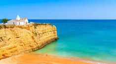 White small church on top of cliff at Armacao de Pera beach, Algarve region, Portugal Copyright Pawel Kazmierczak European Vacation, European Destination, Desert Island, Island Beach, Cool Places To Visit, Places To Go, Best Beaches In Europe, Portugal Holidays, Visit Portugal