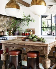 French Moroccan Style Kitchen with Weathered Oak Kitchen Island, Cement Tiles, and White Plaster Walls.