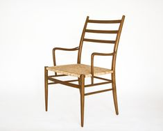 LOGGIA CHAIR Shown: Maple with cane seat
