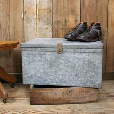 """Galvanized Trunk  by Aurora Mills, 30% off """"This galvanized steel trunk would make the perfect industrial-inspired media stand or coffee table. The heavy-duty steel is riveted together with wonderful details at the seams and corners. Iron handles adorn either side."""""""