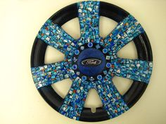 """""""Ford Mosaic' is actually a painted wheelcover that's been rescued from the side of the road and given a 2nd life!"""
