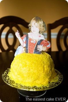 cake cooked in pyrex bowl, flipped upside down and covered in yellow ...