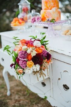 The dressers overflowing with flowers are a lovely touch.
