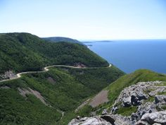 Cabot Trail, Cape Breton, Nova Scotia, Canada. Lovely view of the hills and the sea.  Photo by. J. Underwood.