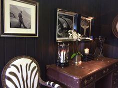 tm design showroom, leather desk and zebra chair.