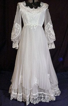 Late 60's  Prairie Gown with lots of lace and pleats <3 Notice the similarities between this and the ancient gown next to it.