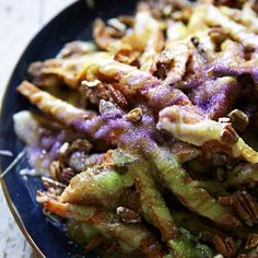 King Cake Fries — cinnamon sugar sweet potato fries, brown butter cream cheese glaze, praline sauce, and toasted pecans. Happy King's Day!