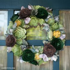 DIY Paper Succulents Tutorial (with free printable pattern for each of the succulents) from Lia Griffith - she shows this wreath and more examples of how to use the paper succulents