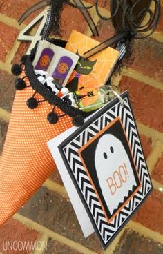 "Neighborhood ""Boo"" printable--but don't you just love the idea of leaving a treat in a paper cone!?"