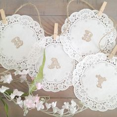 You will adore this sweet and simple DIY paper doily baby banner. It would be perfect for any rustic, vintage, or Shabby Chic style of baby shower and is a great baby shower banner idea.  Its made with delicate 5 inch French lace paper doilies, twine, and tiny clothespins. I have hand stamped each doily to spell the word BABY in fun and fancy letters.  You will receive...  4 (5 inch) doilies 3 ft length of twine 4 sweet little miniature wooden clothespins (they are approx 1 1/2 inches)  ...