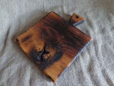 This cutting board made from storm fallen oak. Then I found it in the woods, sawn, dried, and it turned out wood for the production of this board. All the work of the board was made by hand. Board burned on the old wood processing technology. Covered ecological mineral oil and beeswax. Suitable for serving, bread boards, boards for cheese and other foods. Each board is totally unique   Dimensions:  12.2 inches x 7.5 inches (31x19 cm) 1.1 inches thick (0.28 cm)  Care:  Hand wash in warm soapy…