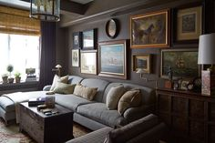 Designed by Robert Passal - Gallery Wall Layout - Wall Paint Color: Well-Bred Brown by Sherwin Williams
