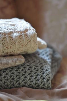 pretty knit sweaters...love the intricacy and neutral colors