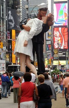 The Kiss statue is officially entitled 'Unconditional Surrender'; it was based on the famous VJ Day photo of a sailor kissing a nurse (the photo was taken by Alfred Eisenstaedt in 1945 and appeared in Life Magazine). The 26F tall statue was created by J.Seward Johnson and was installed in 2010. In 2011, it was relocated to Rome, Italy. There are identical statues in Sarasota, FL and San Diego, CA  http://www.roadarch.com/giants/nj.html