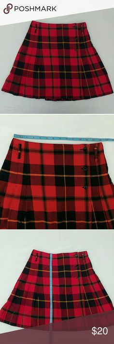 Express Plaid Skirt Express Red and Black Plaid Skirt.  Front Button Closure.  This skirt is meant to be pleated, however it needs ironing to get the pleats back. Size S 100% Cotton  No stains, rips, or buttons missing. Express Skirts