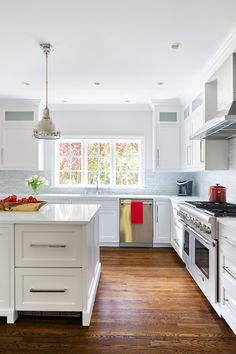 Contemporary Kitchen with Kitchen island, Inset cabinets, Corian-Solid Surface Countertop in Designer White, Crown molding