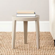 Safavieh Furniture AMH4625C - The tripod-style Wilma Stool is a chic addition to any room. Defined by its casual, elegant style it combines the functional design philosophy of modernism