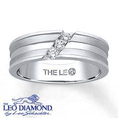Three round Leo Diamonds are angled across stripes of 14K white gold in this sleek men's wedding band. The ring has a total diamond weight of 1/6 carat. Diamond Total Carat Weight may range from .145 - .17 carats.