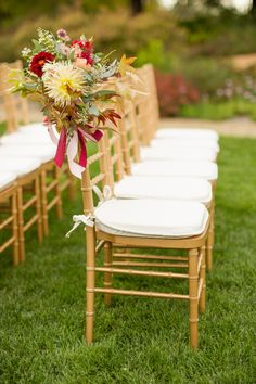 Fall floral accented ceremony chairs: http://www.stylemepretty.com/california-weddings/santa-rosa/2016/05/23/this-destination-wedding-is-the-ultimate-family-affair/ | Photography: Mike Larson - http://mikelarson.com/
