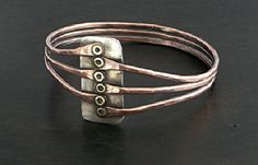 Bracelet | Laura Bouton.  Copper, brass and sterling silver.