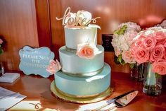 Blue ombre wedding cake with gold + pink accents. | Photo: Lavish Touch Photography | Cake: Love + Buttercream