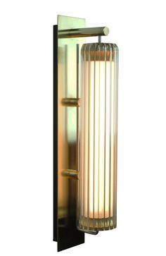 Elegant glass wall light inspired by lighthouse lens design with soft warm light effect. Wall body, arm and plate in brass or stainless steel. Indoor Wall Lights, Glass Wall Lights, Wall Lighting, Wall Lamps, Wall Sconces, Light Effect, Architecture Design, Chandelier, Patio