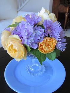 Lovely blue hydrangeas and yellow roses create a Moments of Delight...Anne Reeves